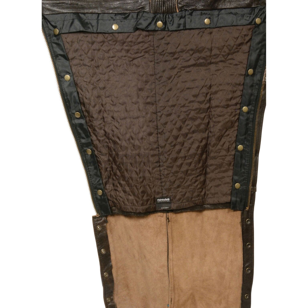Inside leg view of lining and leg seam of premium distressed brown leather riding chaps, made from soft, milled naked cowhide leather.  Snap out liner for changes in weather.  Heavy side zippers run from hip to just below the knee, snaps run remaining length of leg.  Available in our shop in Smyrna, TN, just outside Nashville.