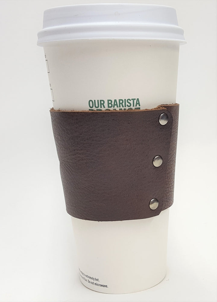 alternate view of Brown leather coffee cup sleeve with silver colored rivets along connecting edge. Made from brown cowhide in the shop just outside Nashville in Smyrna, TN