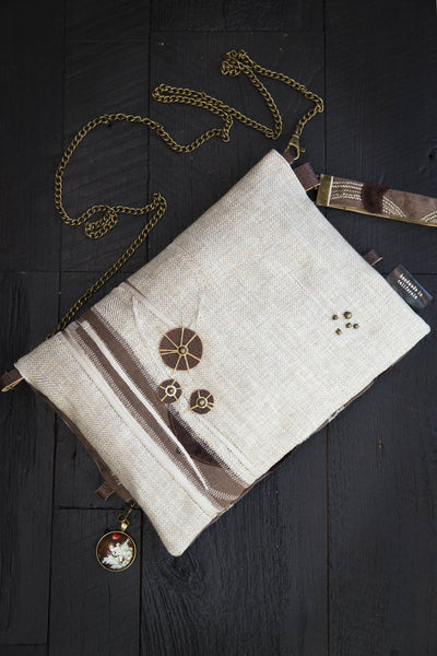 One-of-a-kind fold-over clutch/bag. Handmade wearable art in shades of brown and cream luxurious linen fabrics and leather and a coconut button.