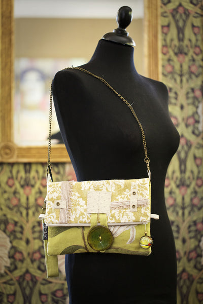 One-of-a-kind fold-over clutch/bag. Handmade wearable art in embroidered chartreuse and cream luxurious linen and cotton.