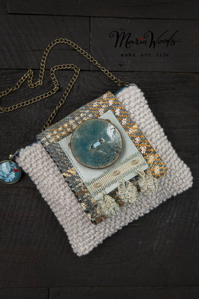 One-of-a-kind clutch/shoulder purse. Wearable art, handmade in smokey grey and pale blue luxurious fabrics.