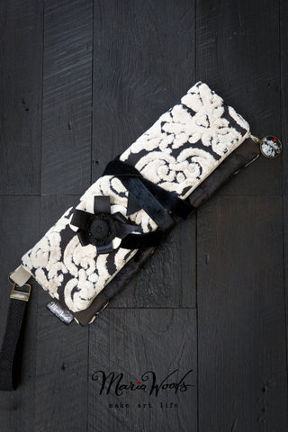 One-of-a-kind fold-over clutch. Handmade wearable art in striking black and cream luxurious designer fabric.