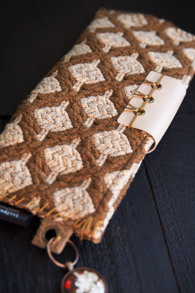 One-of-a-kind clutch. Wearable art, handmade in brown and cream luxurious fabrics. Metal and leather accents.