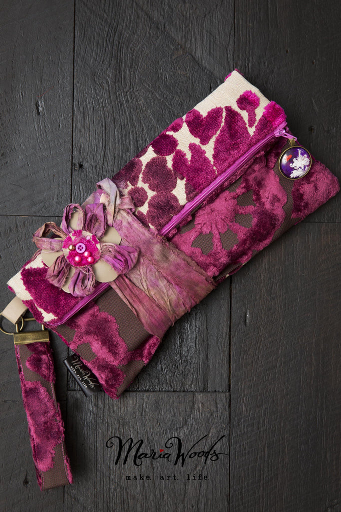 One-of-a-kind fold-over clutch. Handmade wearable art in shades of magenta, aubergine and hot pink luxurious designer fabric.