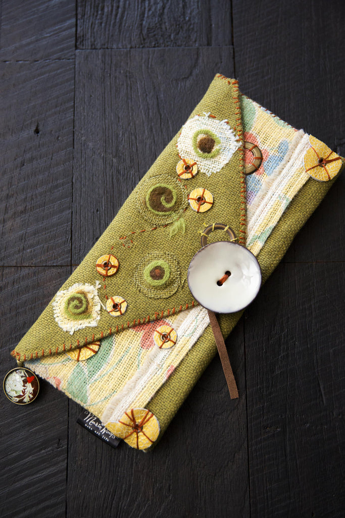 One-of-a-kind clutch. Wearable art, handmade in olive green and yellow burlap. Felted wool, metal and leather accents.