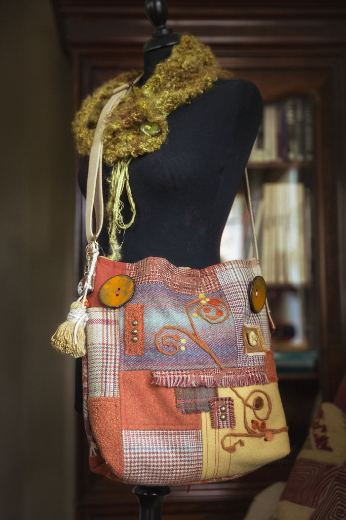 One-of-a-kind cross-body bag. Handmade wearable art in rich fall color tones. Mulberry Home wool fabric, needle felting and coconut buttons