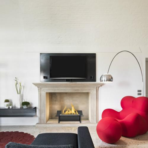 freestanding ehtnanol fireplace below TV