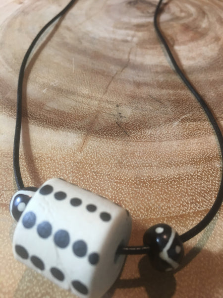 Adjustable choker with ceramic bead