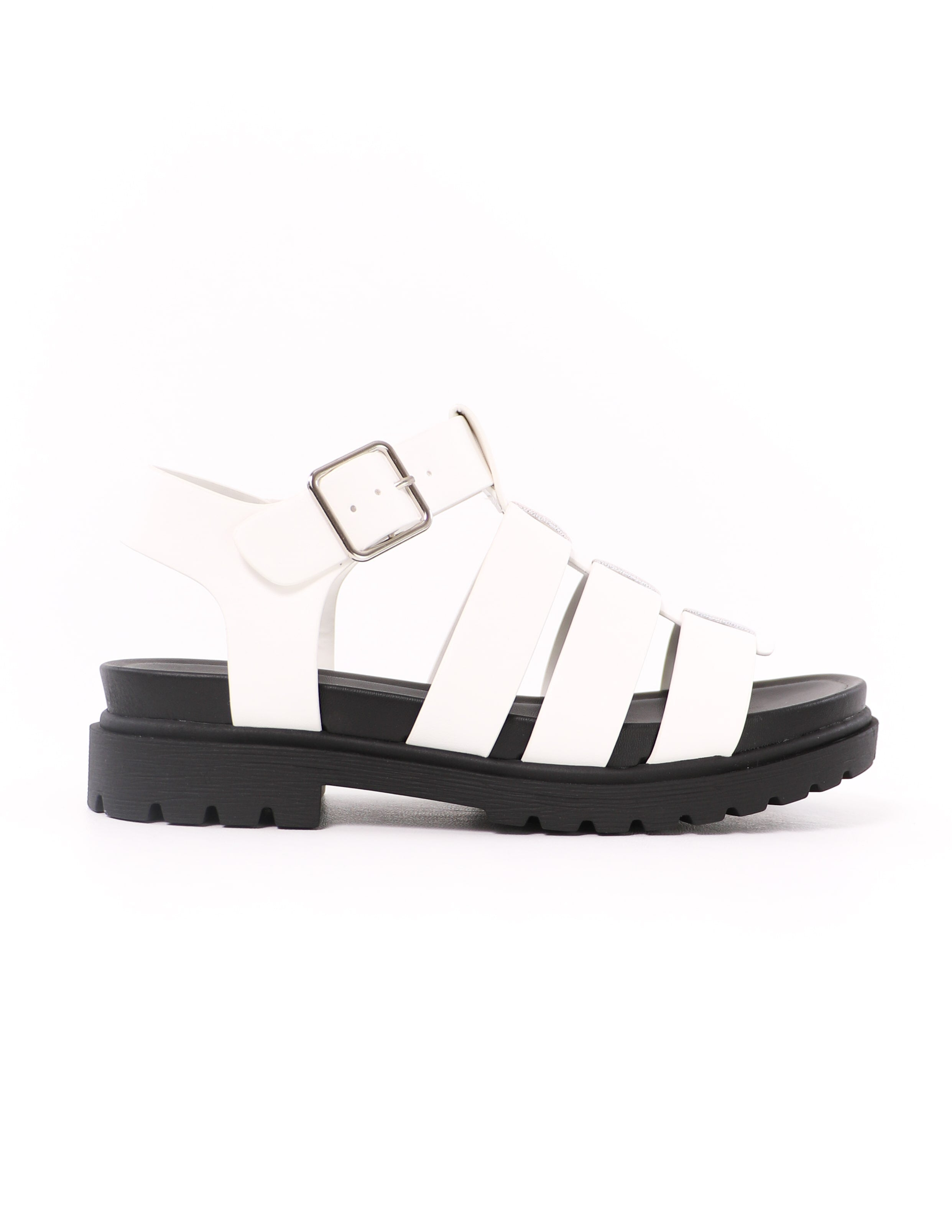 white vegan leather straps and black sole on the later gladiator platform sandals