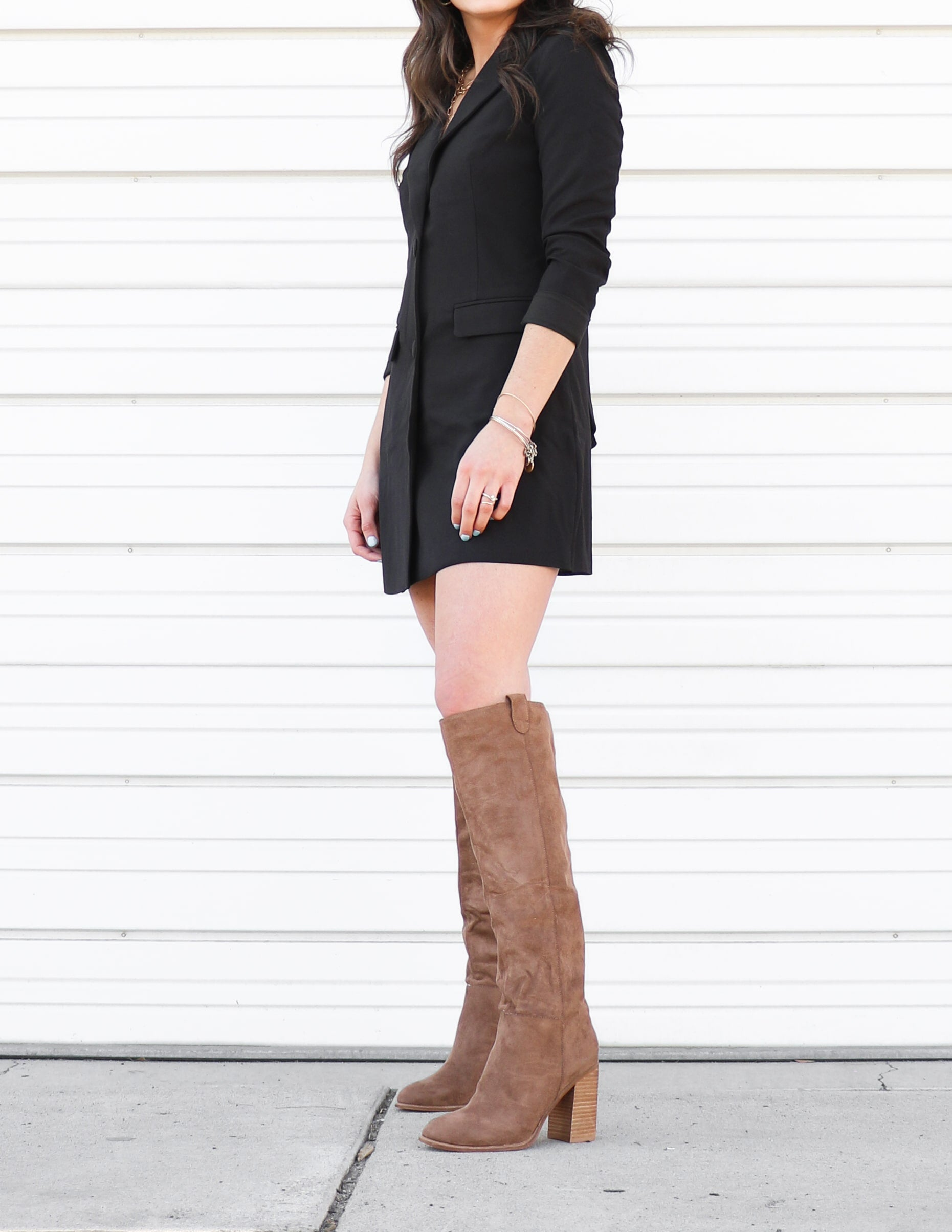 Model standing in the tall thoughts boot in camel