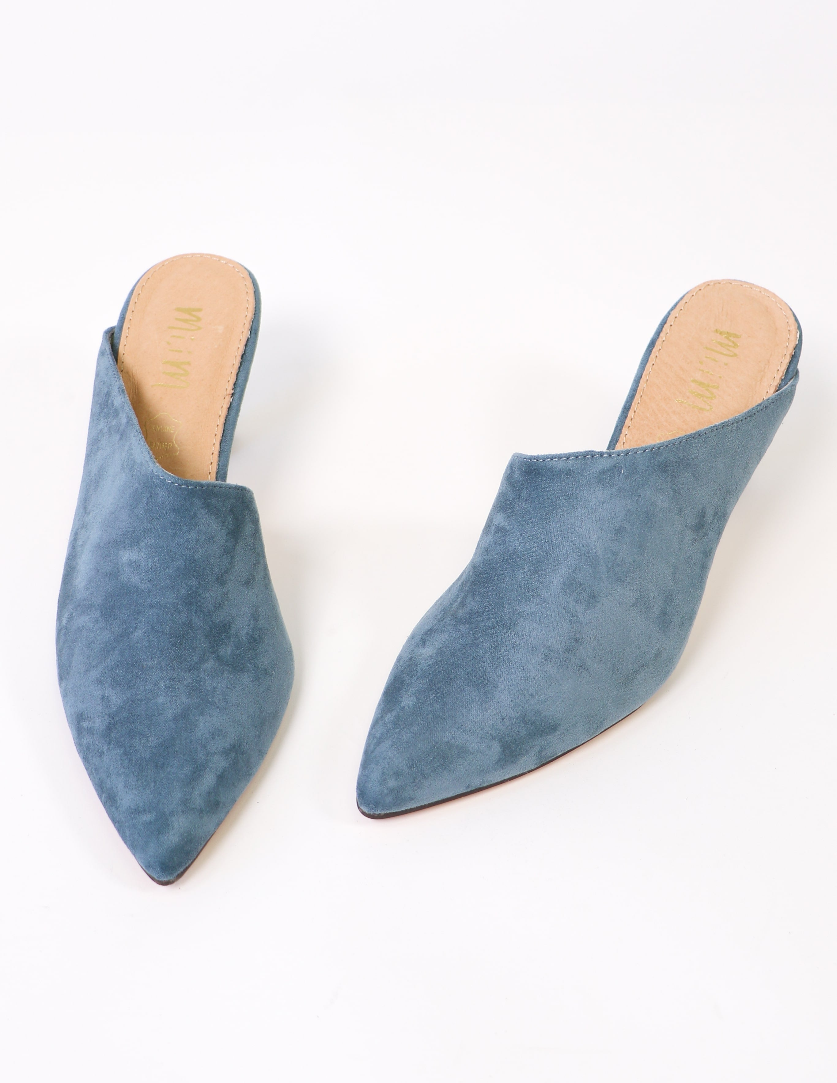 Blue suede kitten heel with asymmetrical upper on white background
