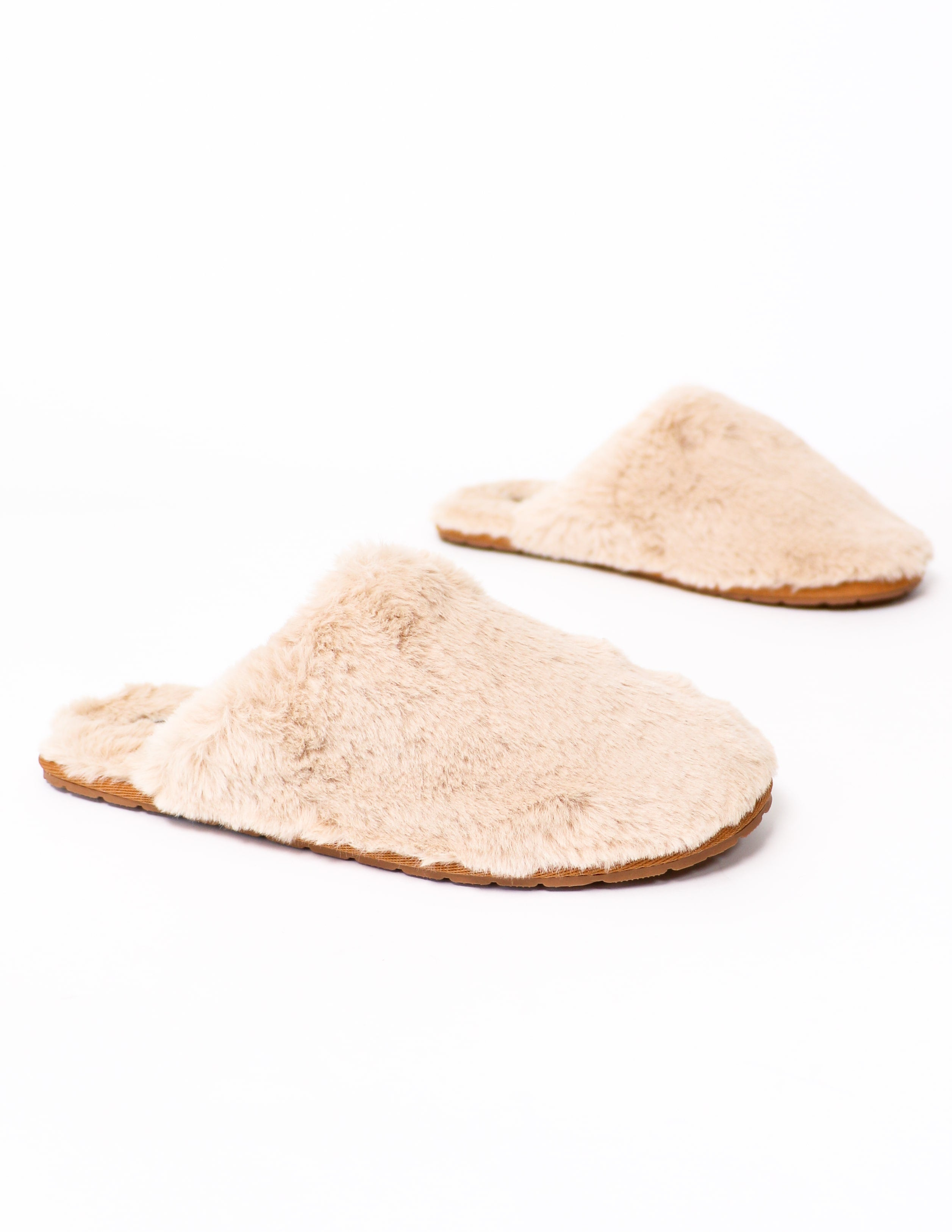 Close up of the natural fuzzy wuzzy slippers on white background