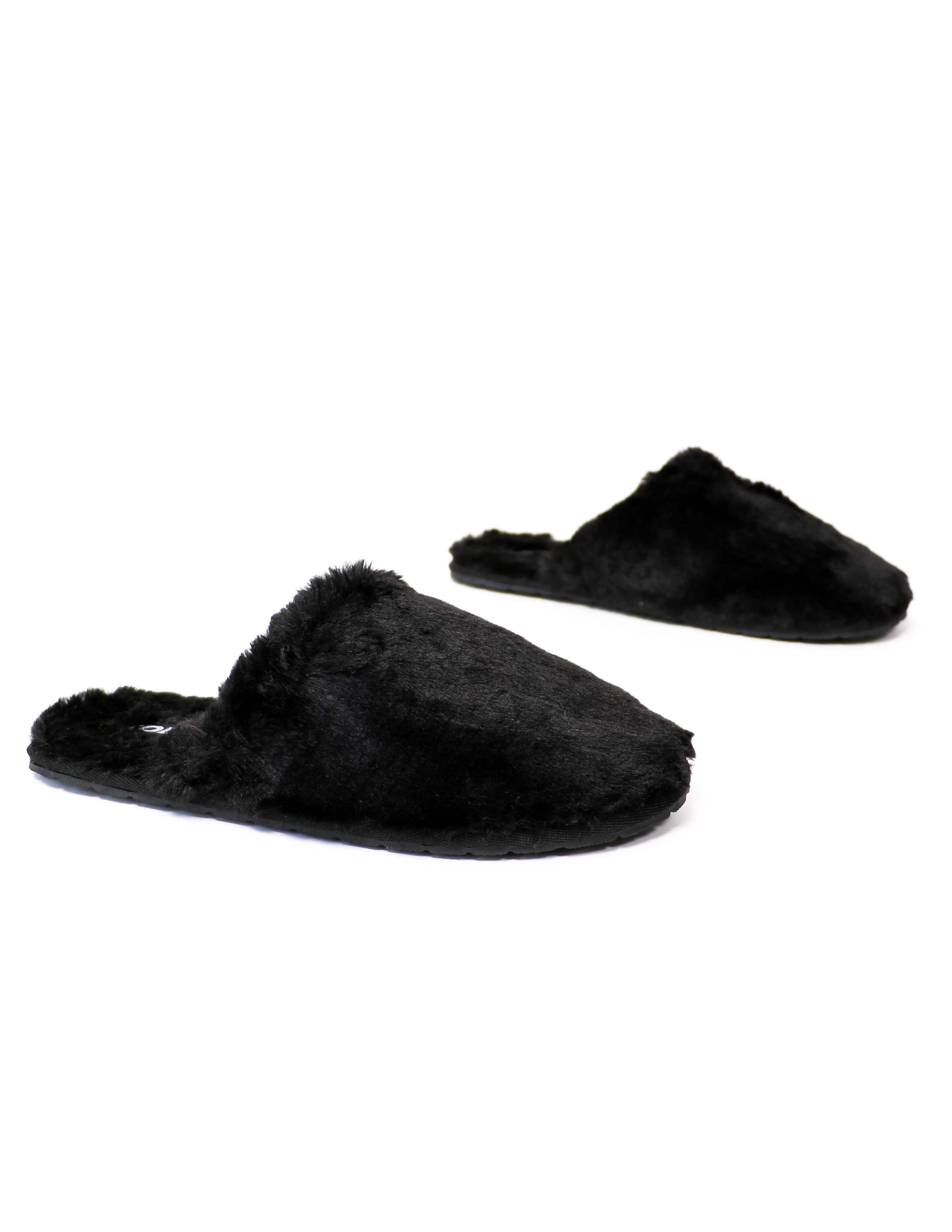 Black faux fur fluffy slippers on white background