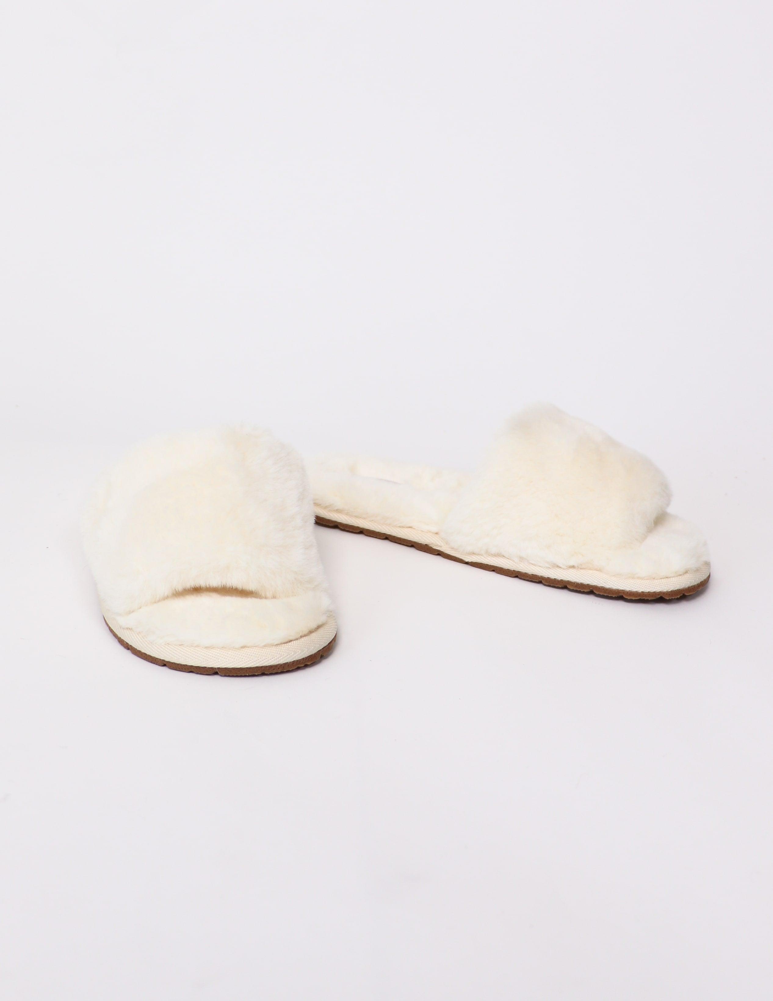 Cream cozy for you slide slippers on white background