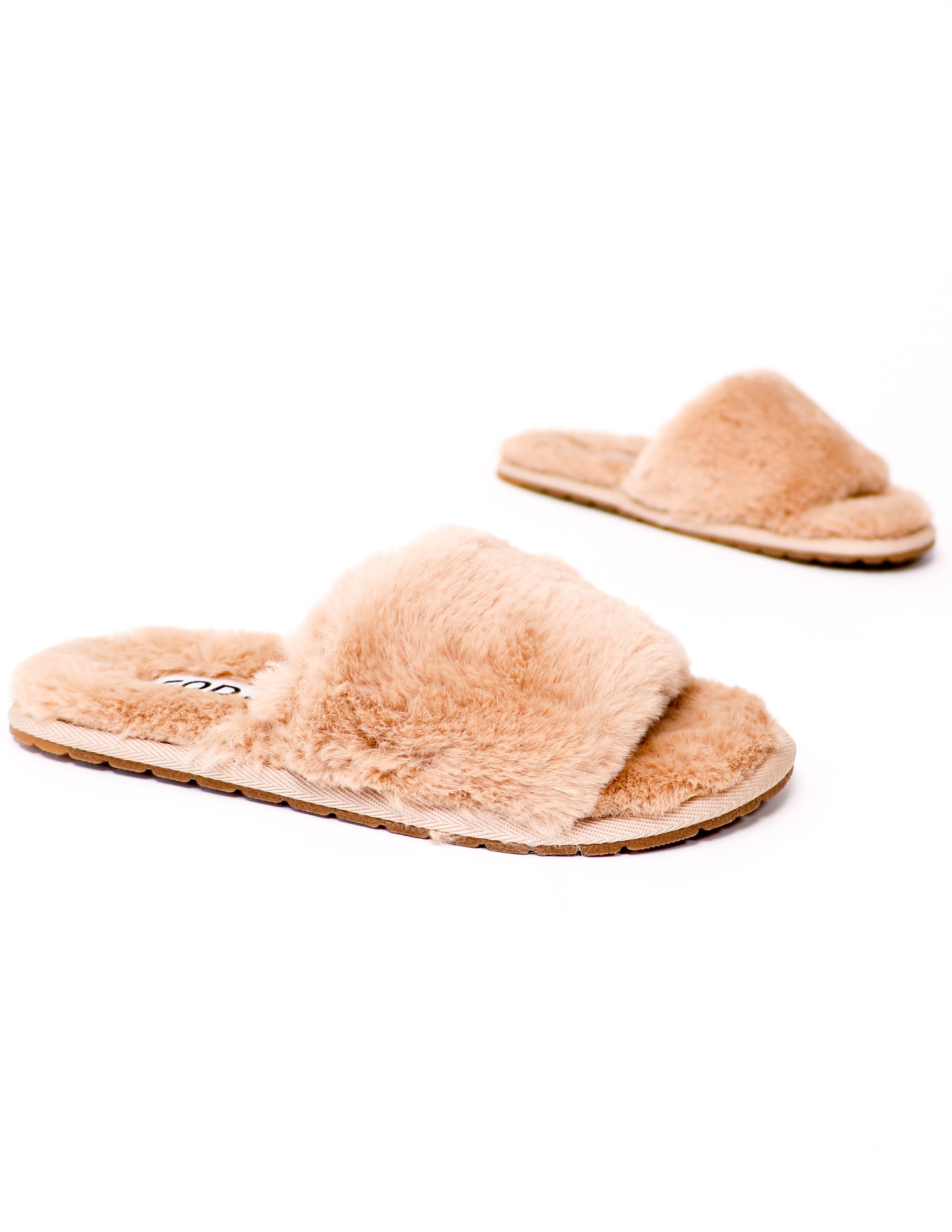 Natural cozy for you slippers on white background - elle bleu
