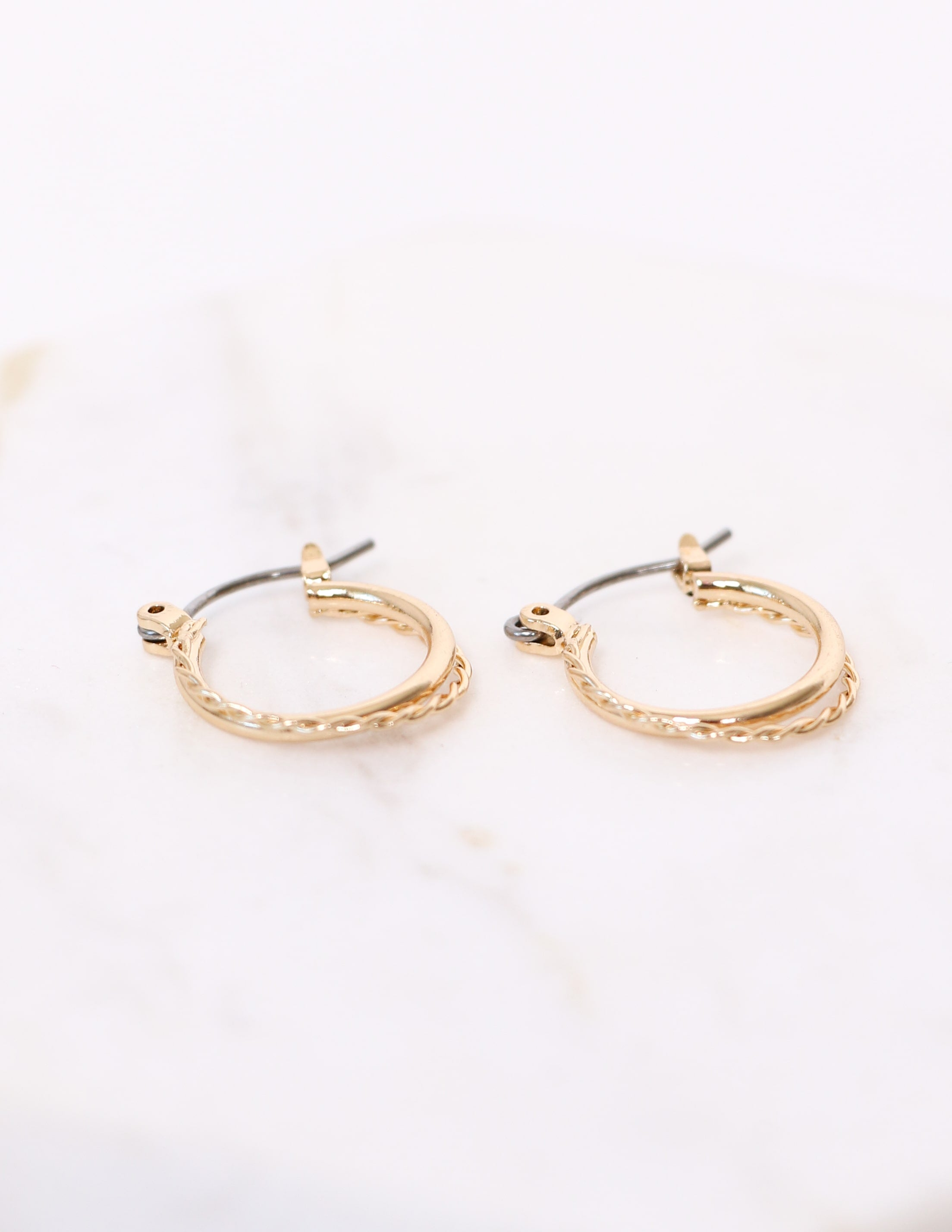 Gold two band hoop earrings on marble background - elle bleu