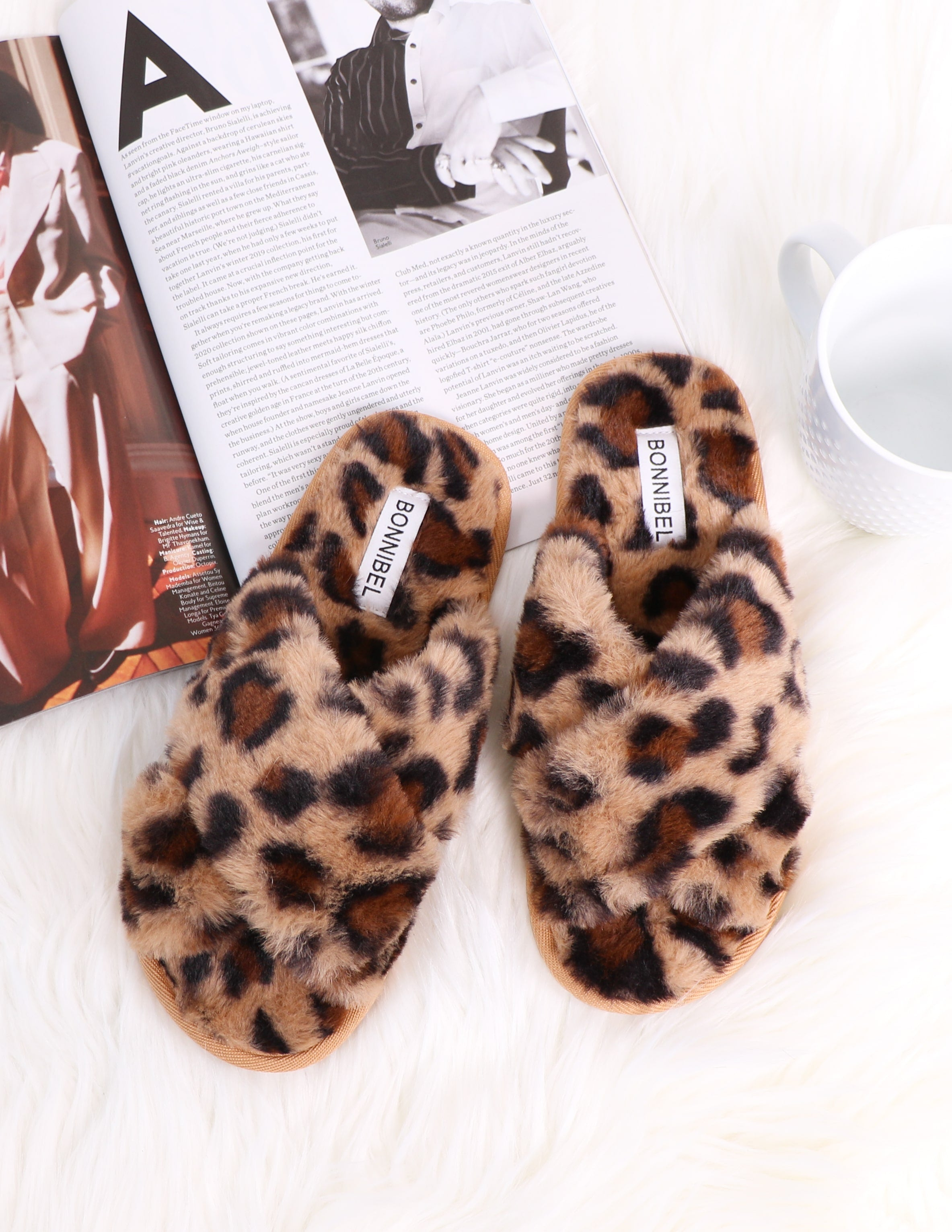 Leopard fur the dreamers slipper on white fur rug - elle bleu