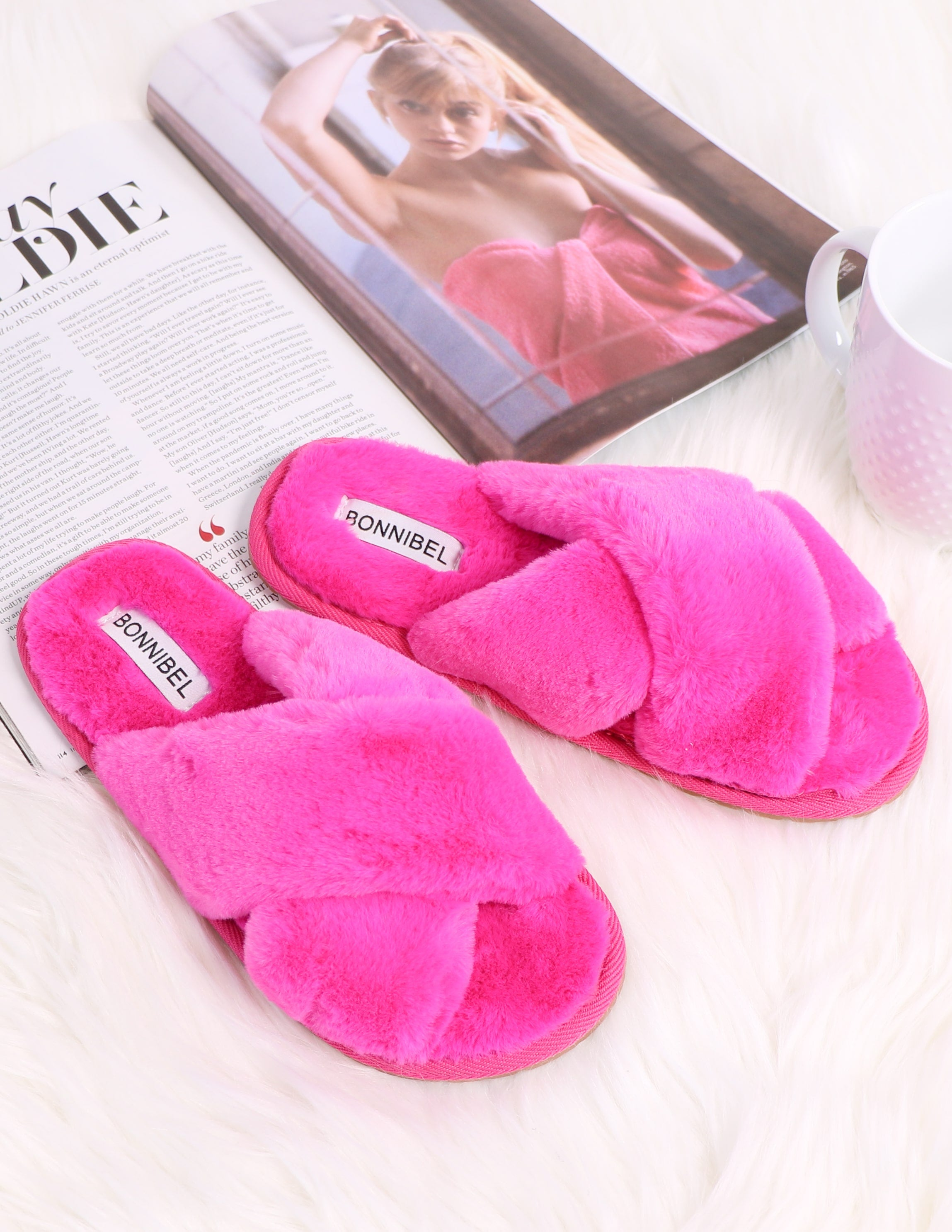 Fuschia fur the dreamers slipper on magazine and white fur rug - elle bleu shoes