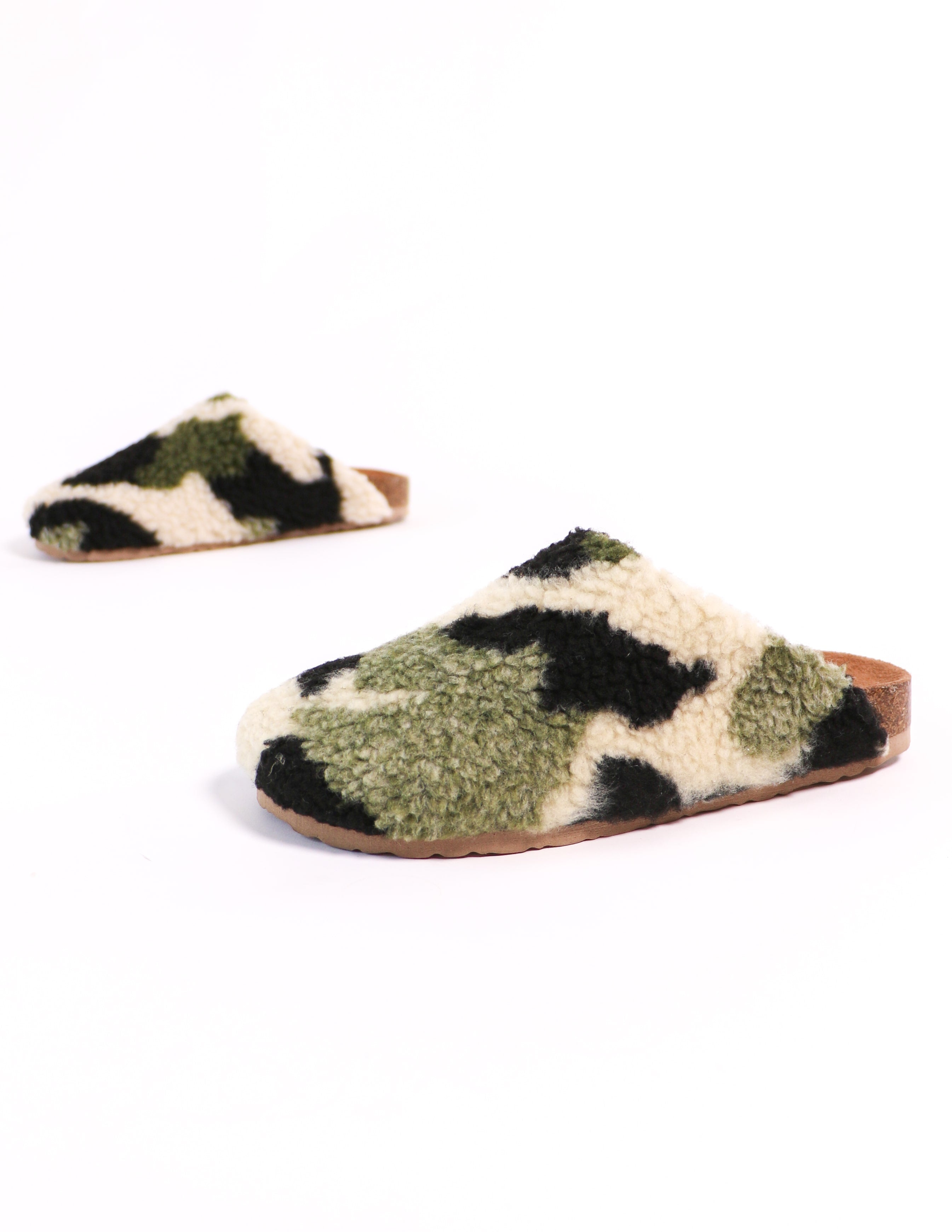 Camo faux shearling clogs on white background - elle bleu shoes