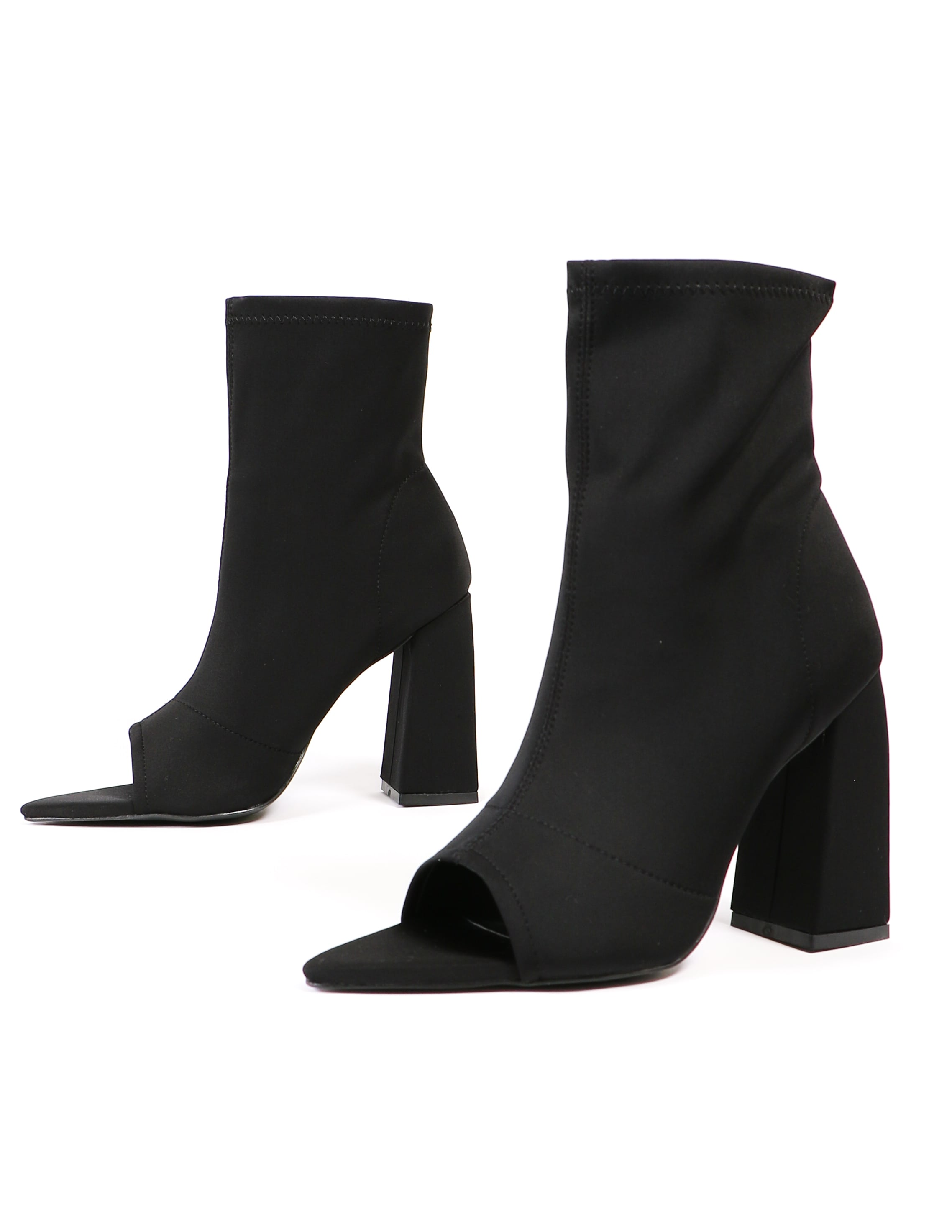 Sit tight black heeled booties on white background - elle bleu shoes