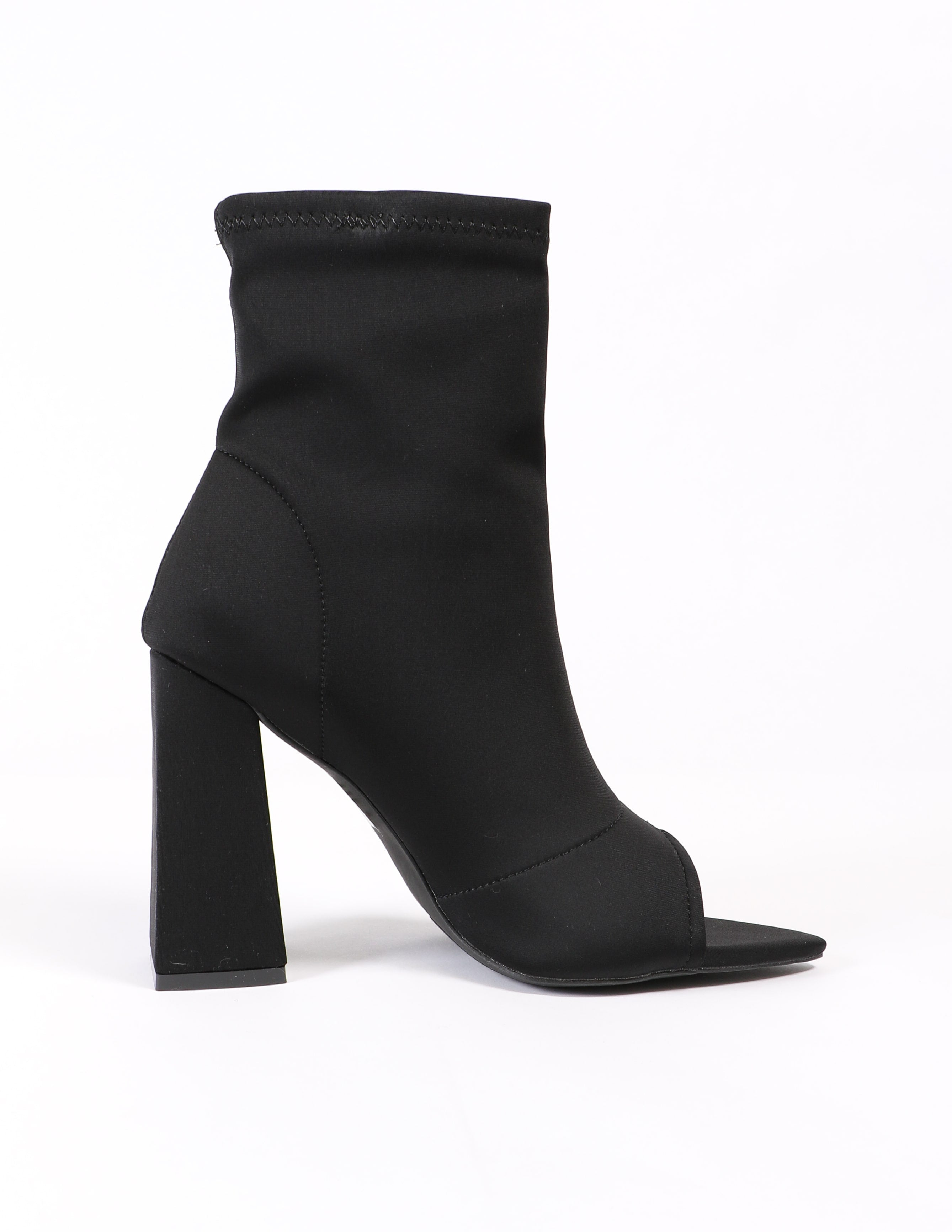 Black sit tight bootie on white background - elle bleu shoes