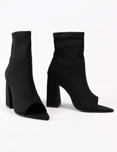 Black sit tight bootie with open toe and pointed footbed