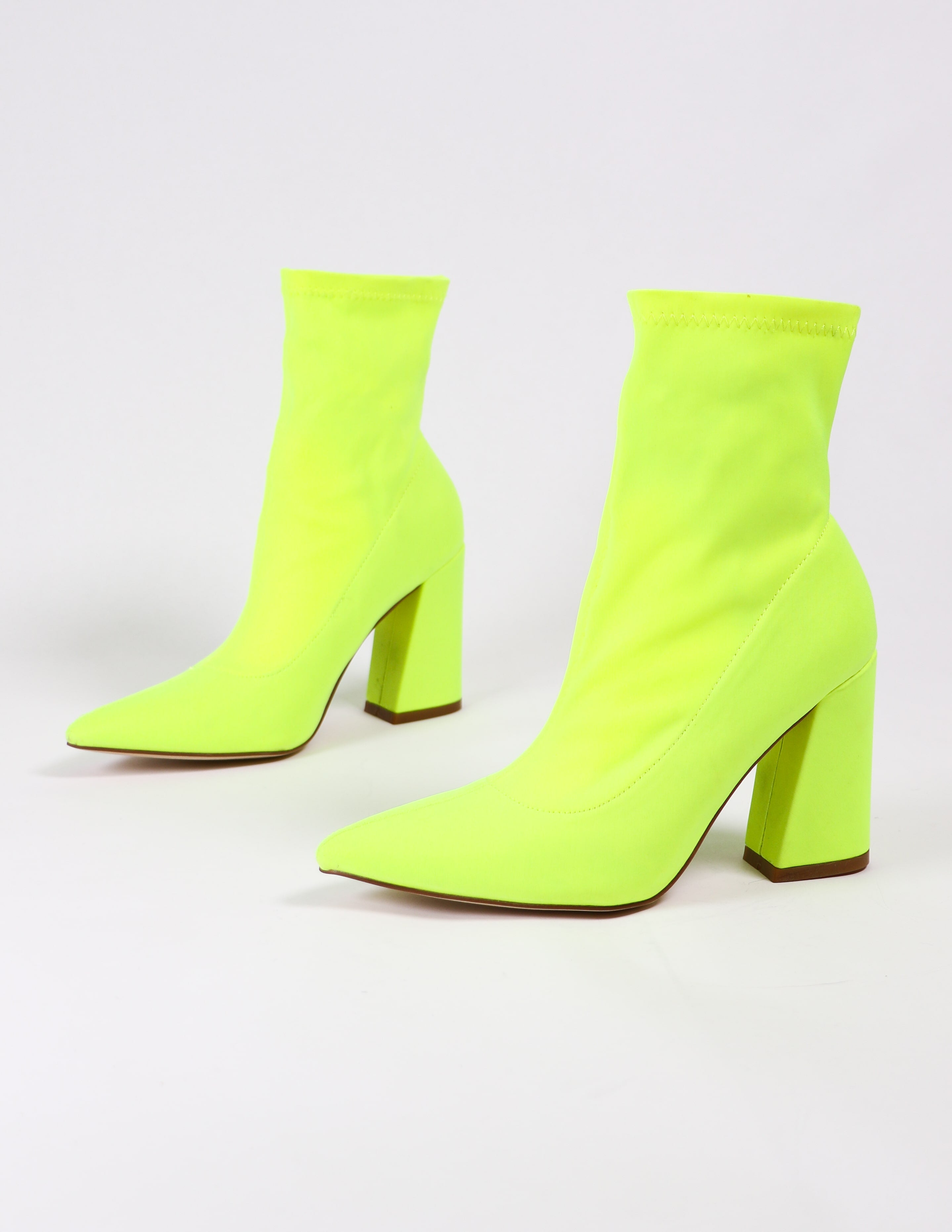 highlight of my life lime green booties on white background