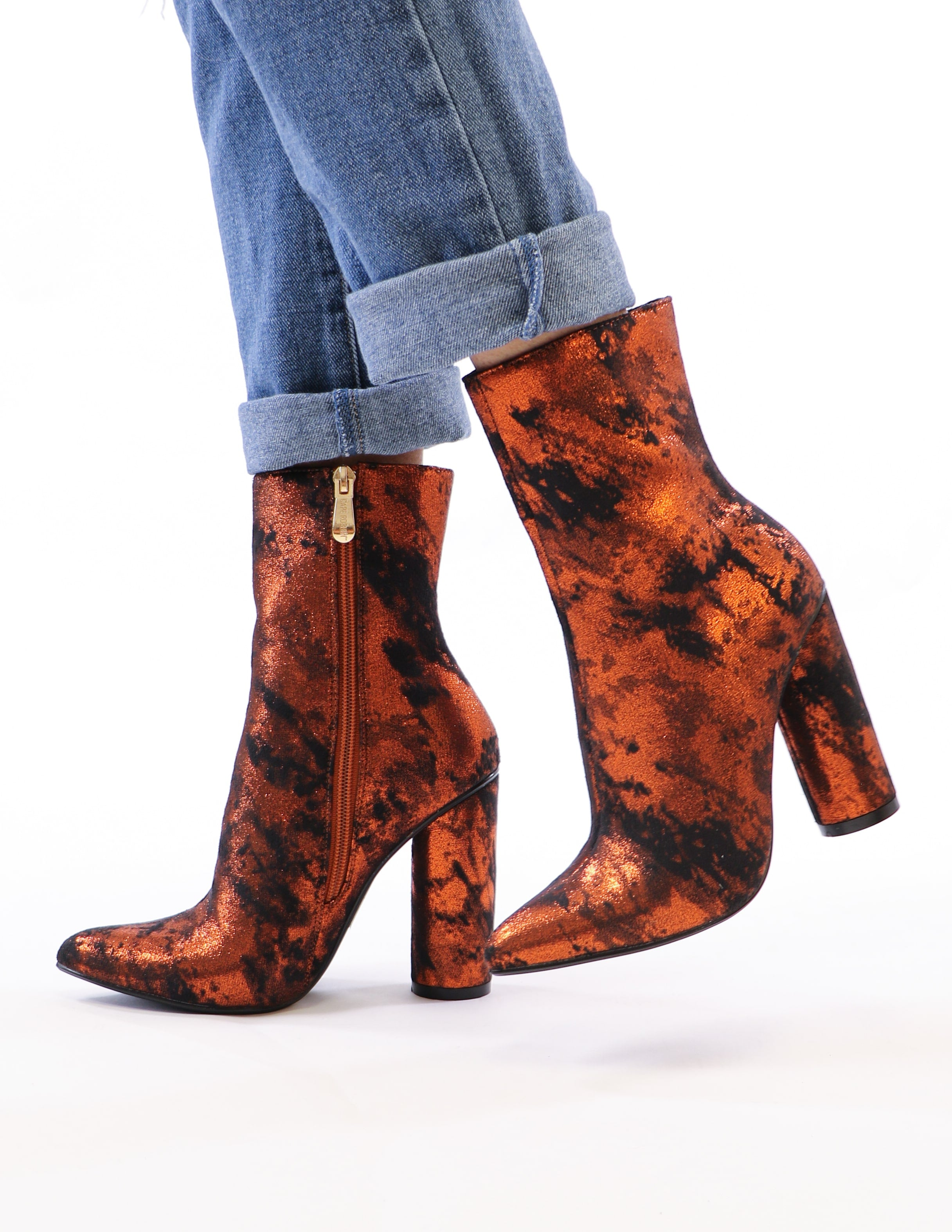 model standing in rust metallic booties - elle bleu shoes