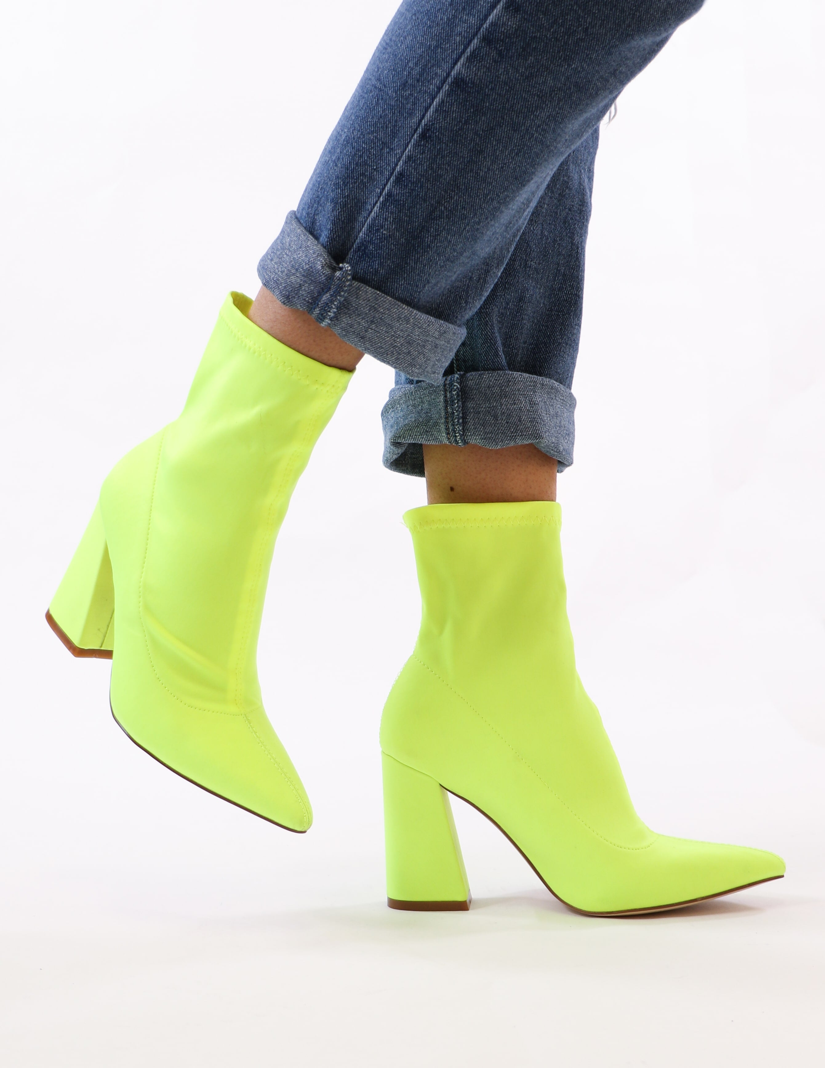 model standing in lime green highlight of my life bootie - elle bleu