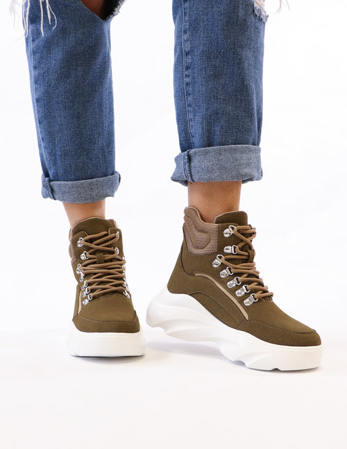 model standing in khaki green run for it sneaker - elle bleu shoes