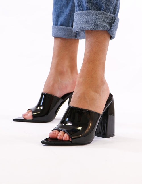 model standing in black explain your point heel - elle bleu shoes