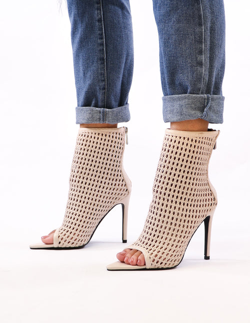 model standing in weave only just begun heels - elle bleu shoes