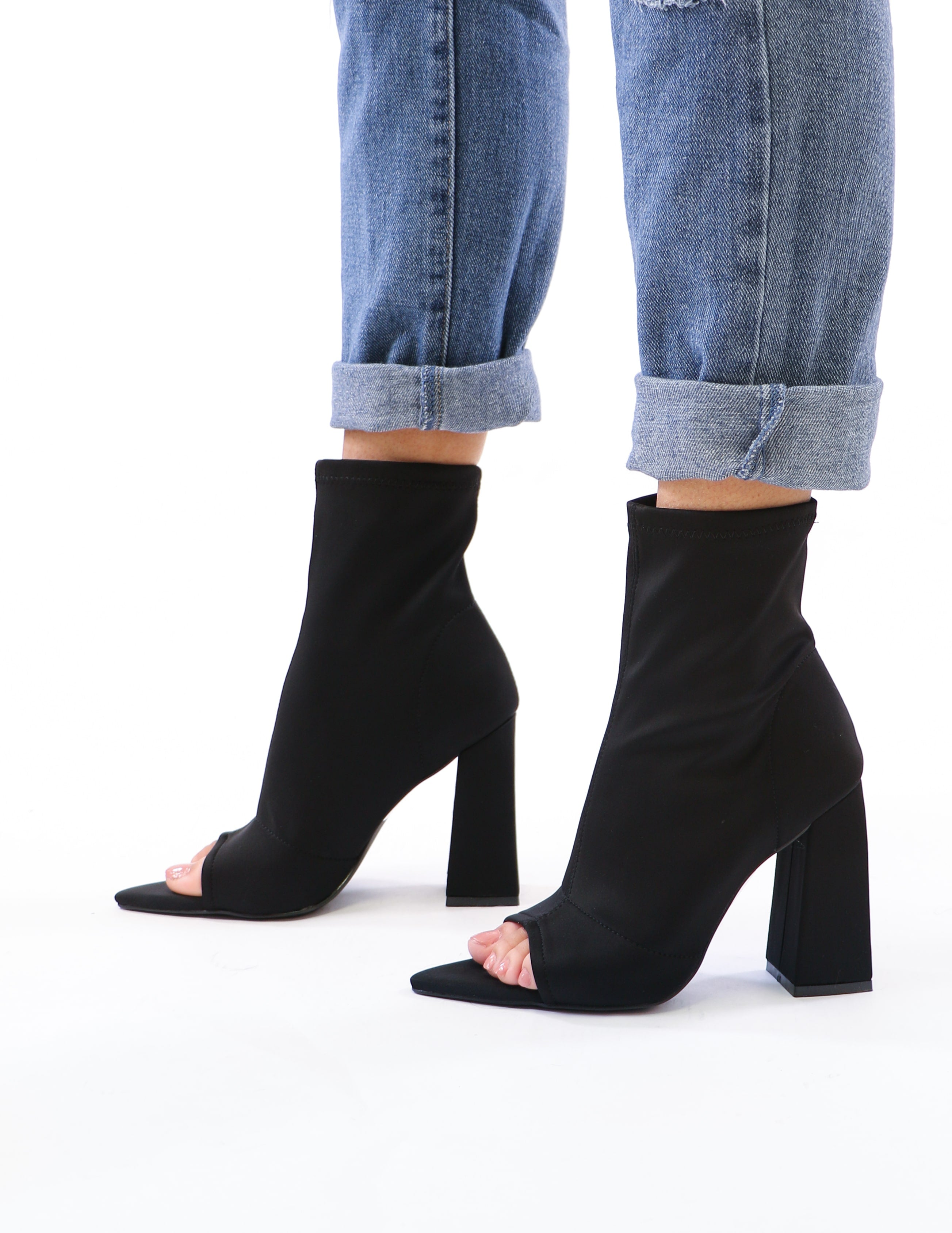model standing in black sit tight bootie - elle bleu shoes