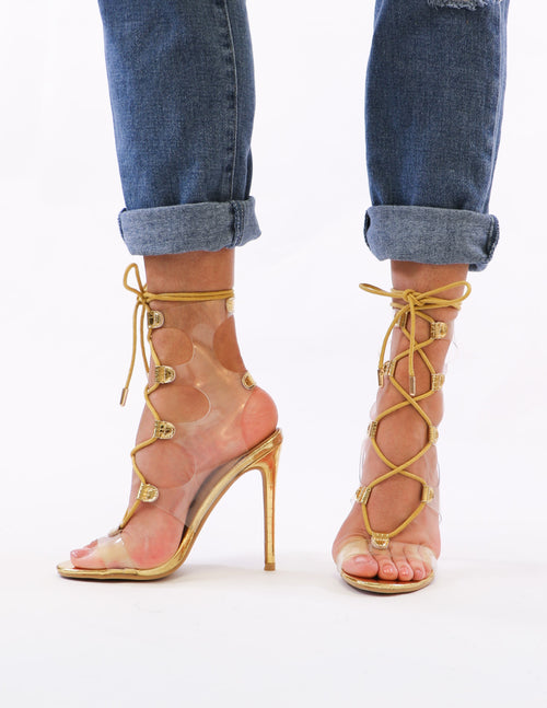 model standing in gold lace up heels - elle bleu shoes