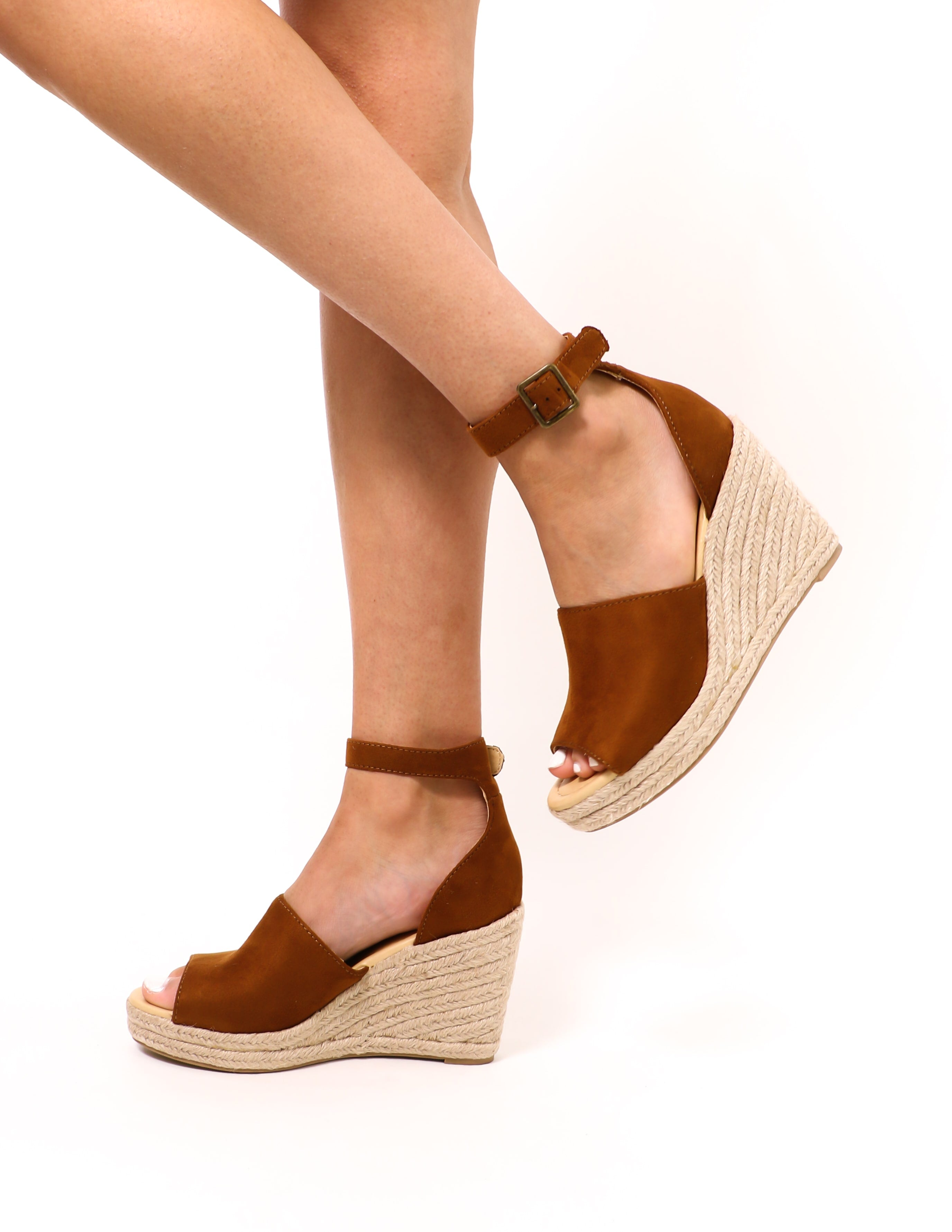 model walking in the tan this is not a espadrille wedge sandal - elle bleu shoes