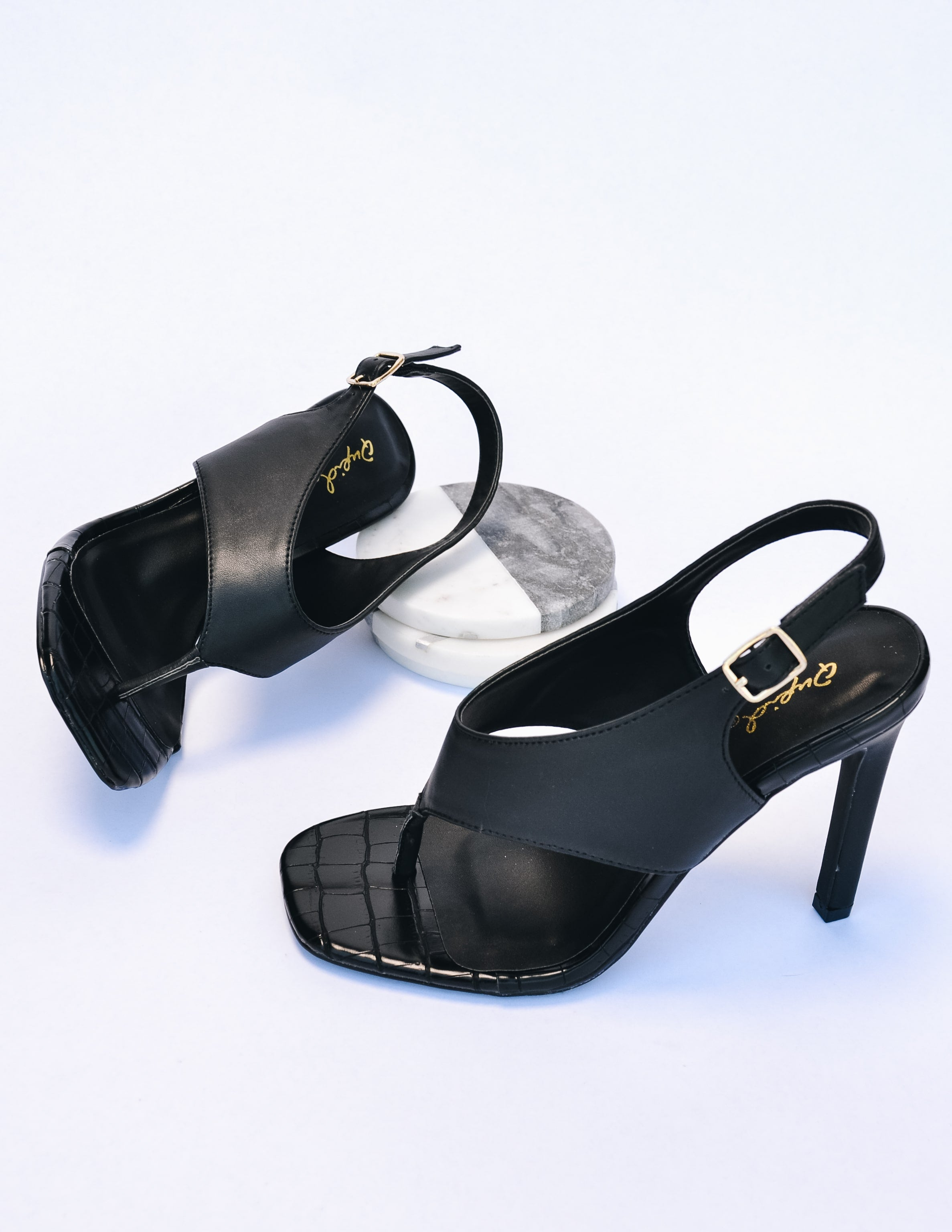 Club can't sandal me heel in black on white background