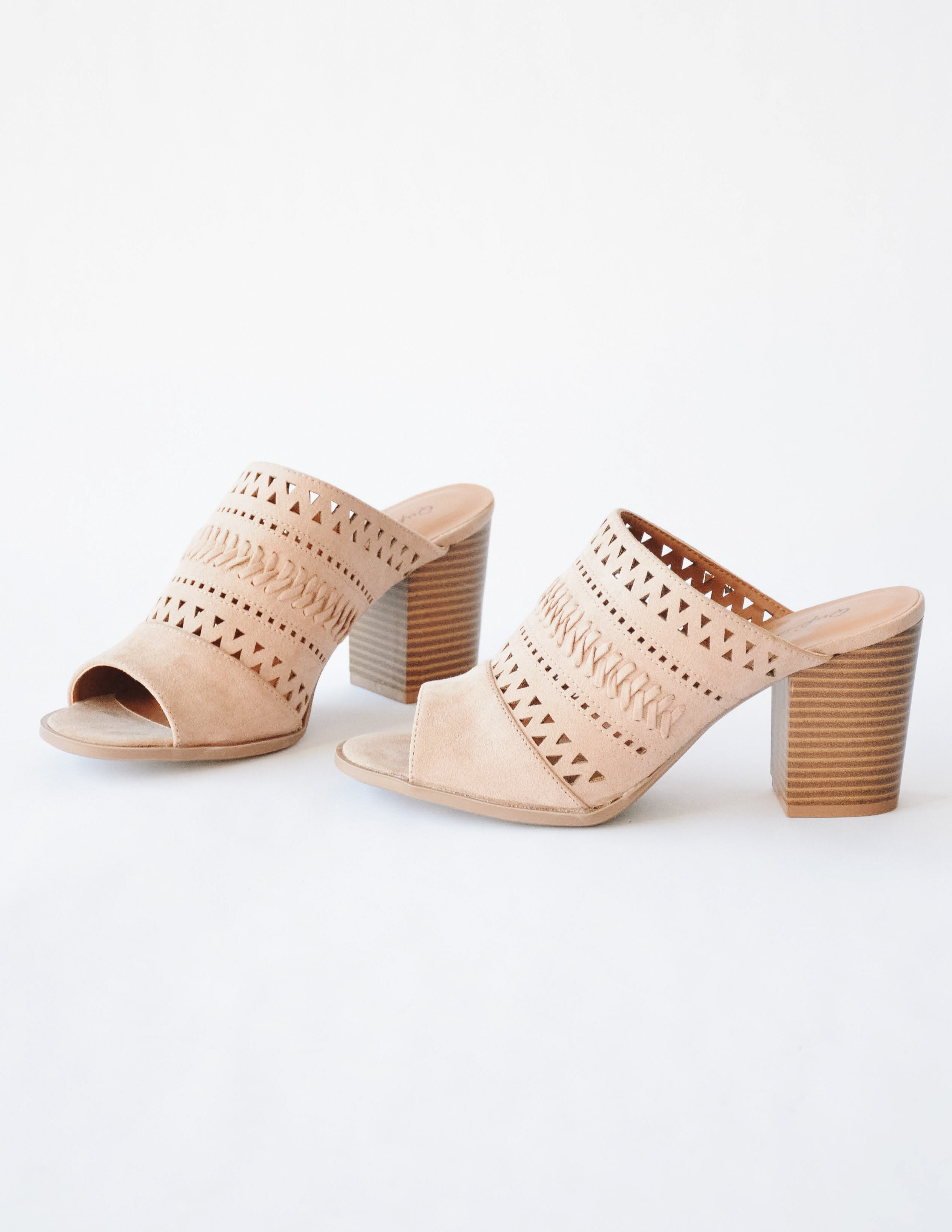 Warm taupe highly selective faux suede heel with laser cut details and embroidery