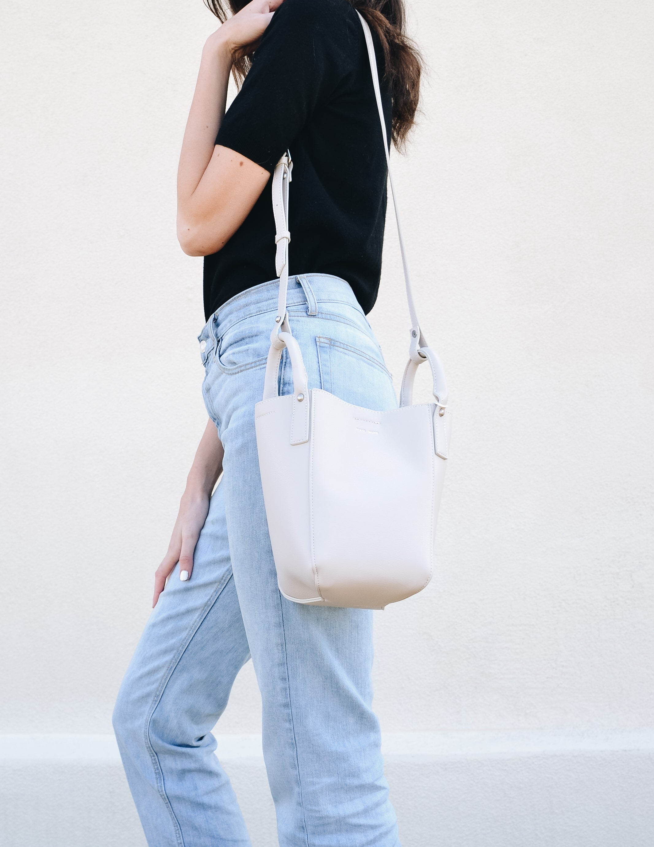 Cloud light smoky lavendar colored bucket bag with removable strap on handles