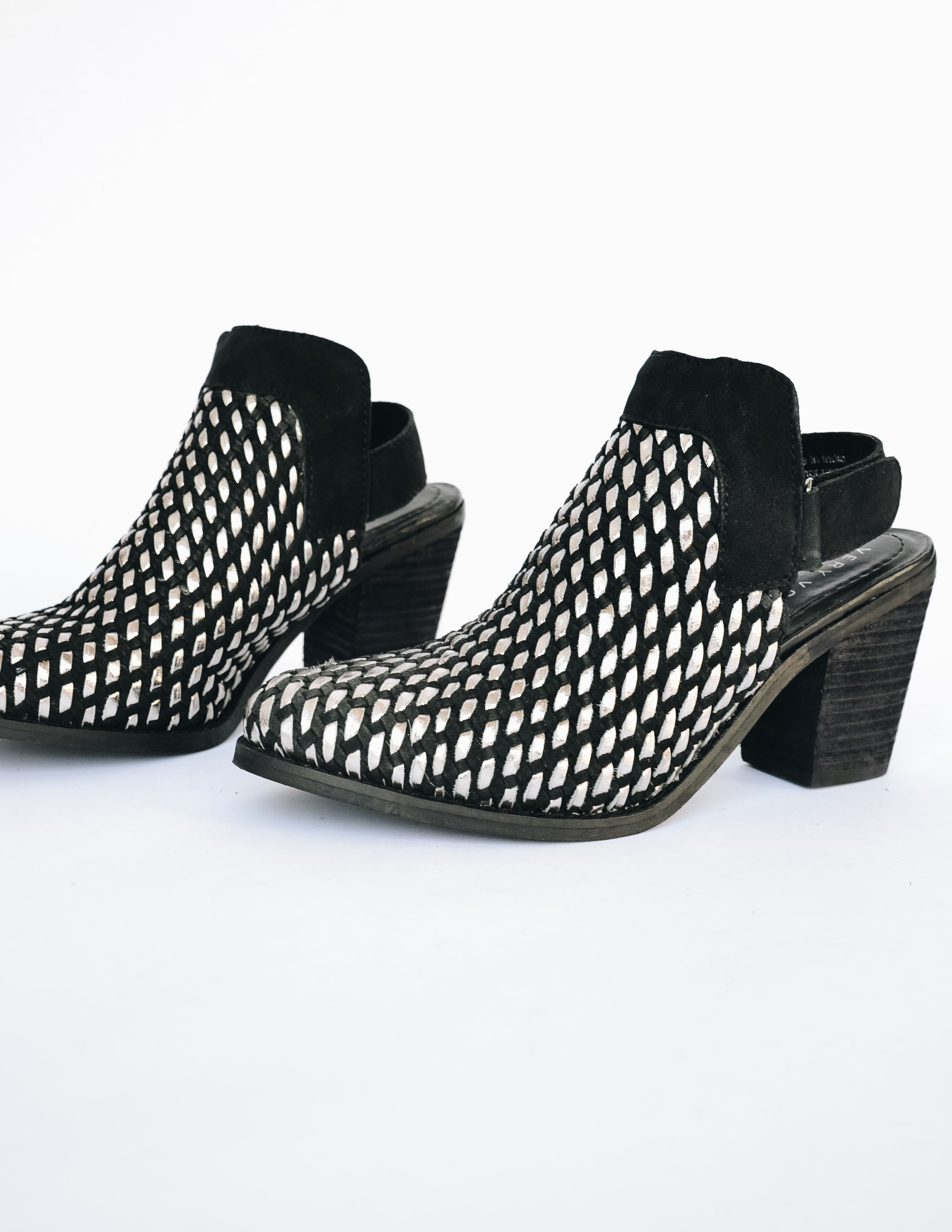 Front of Volatile Sandara heel with almond toe and silver and black woven upper