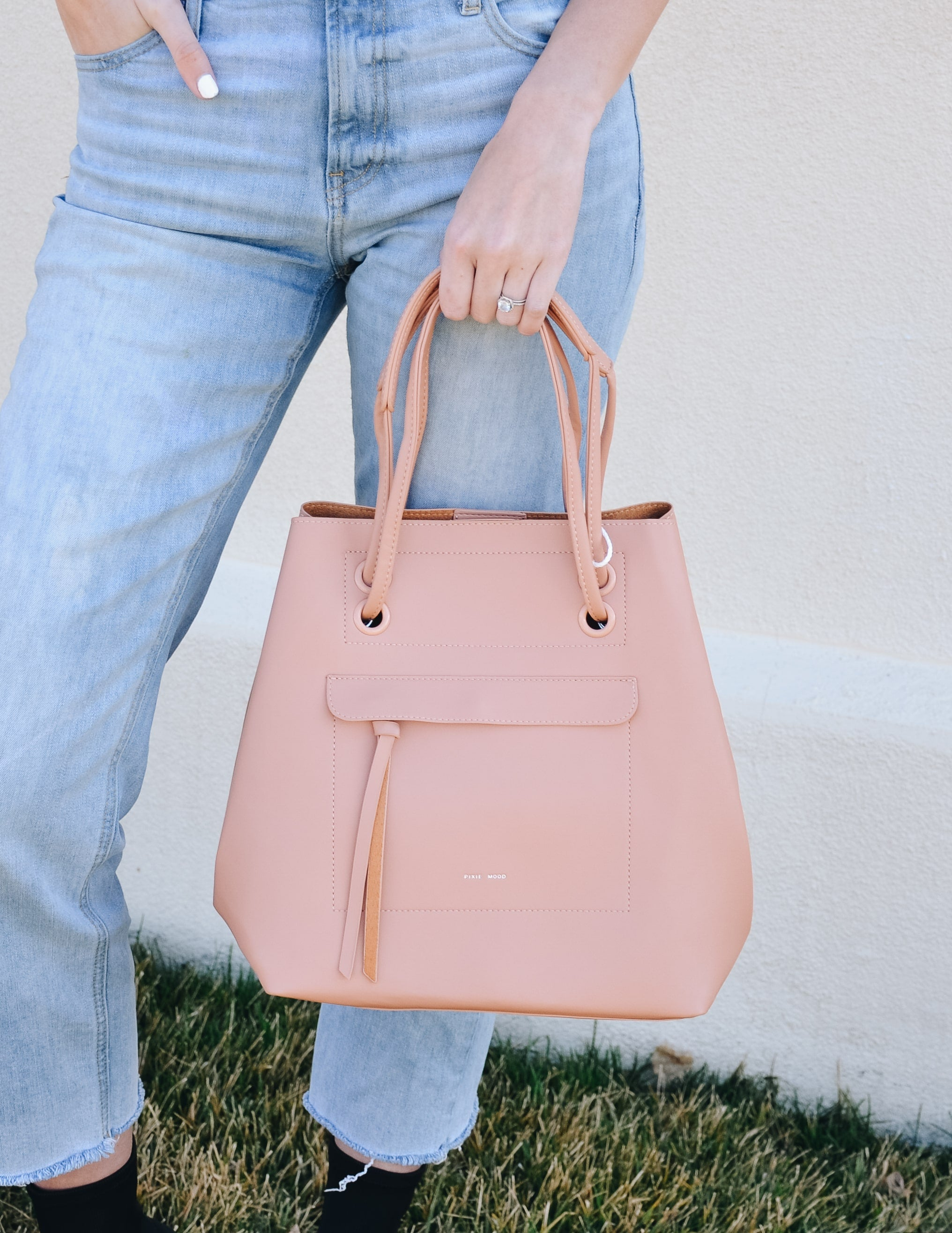 Apricot pixie mood molly bag with front pocket and slouchy shape