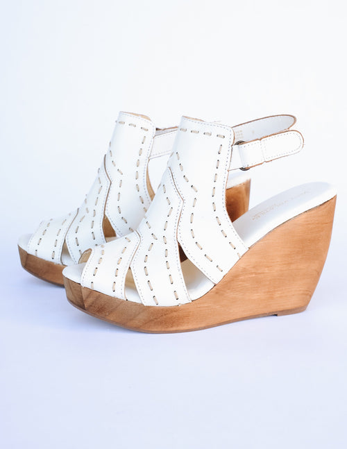 White bolanos wedge with open toe and open back on white background