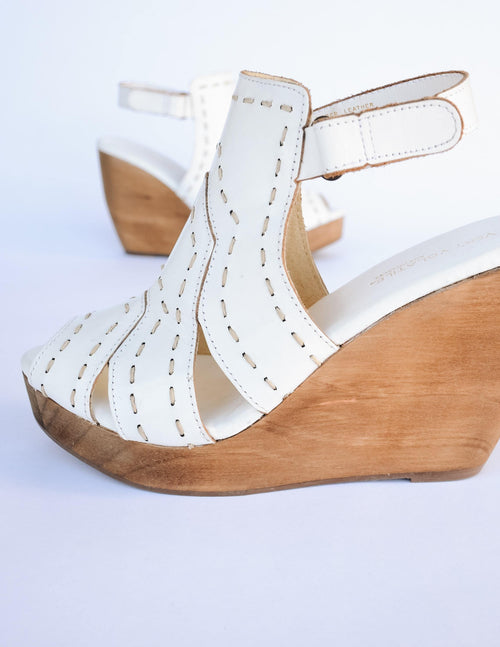 White bolanos wedge with tan wester inspired stitching and tan wood heel