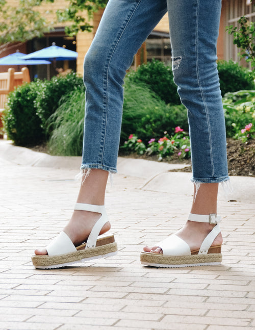 model walking in white aphrodite platform sandal outside - elle bleu shoes