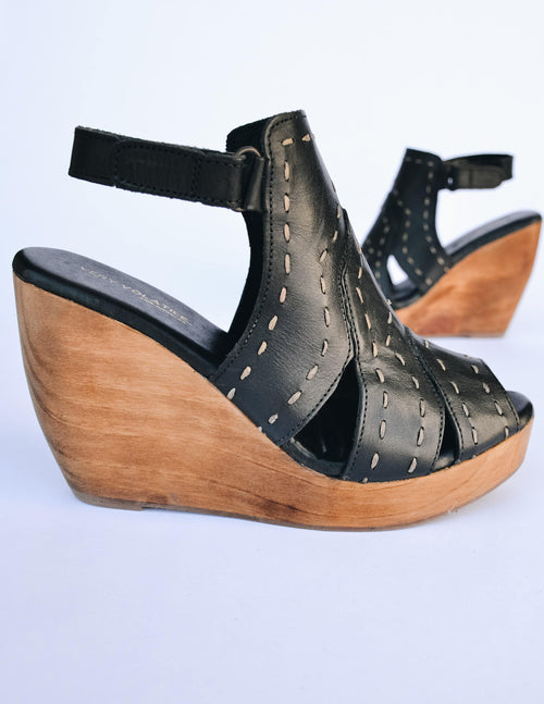 Side view of the bolanos black wedge with open toe and open back