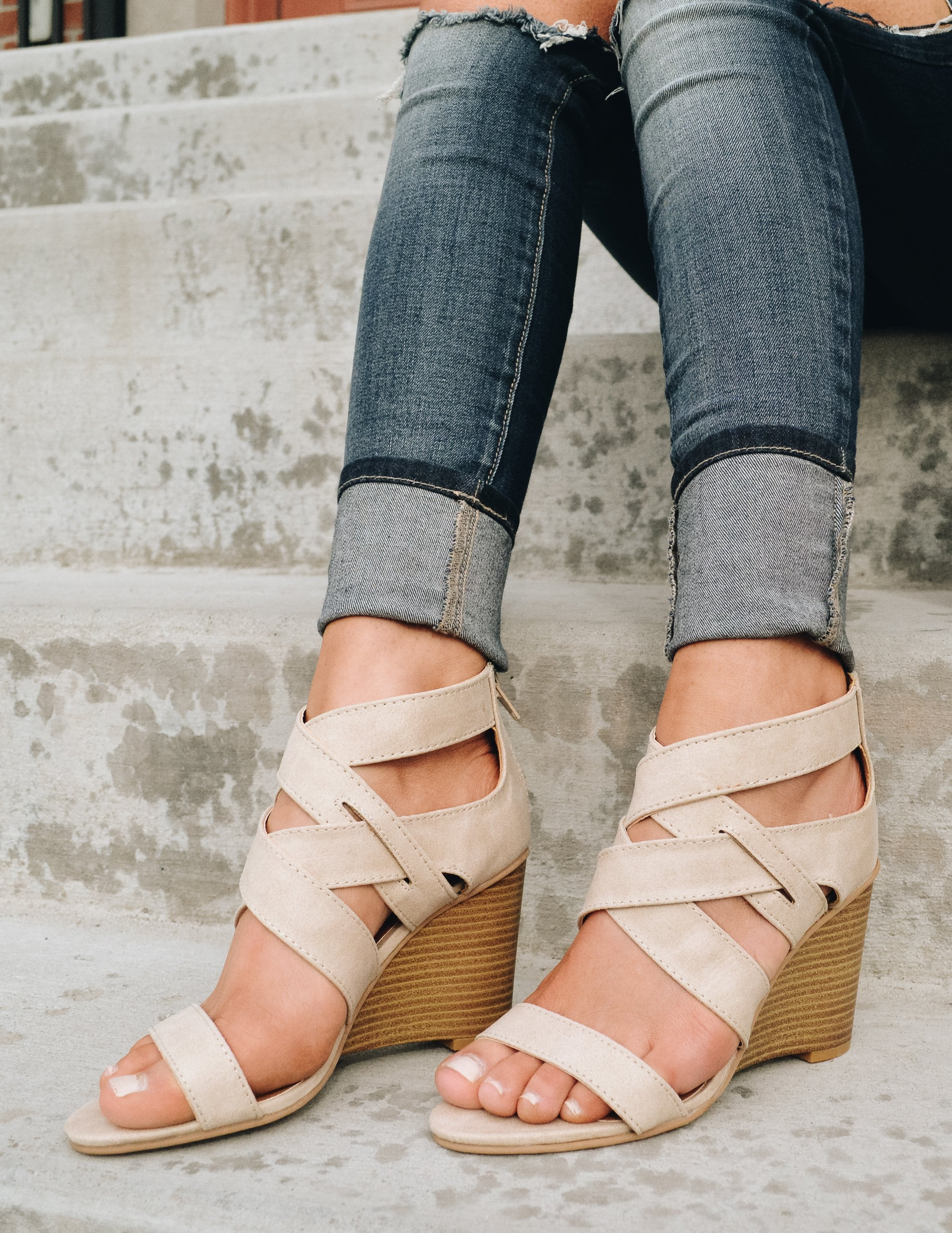 Beige colored strappy wedges with faux stacked wood wedge heel