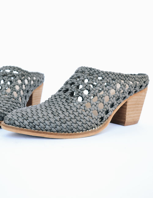 Grey Paris mule with basket-woven details and stacked wood heel on white background