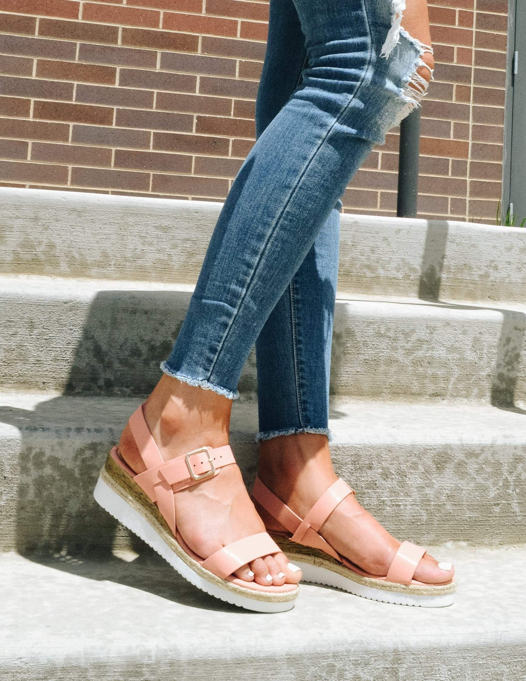 Model standing showing off pink platform wedge sandals - elle bleu