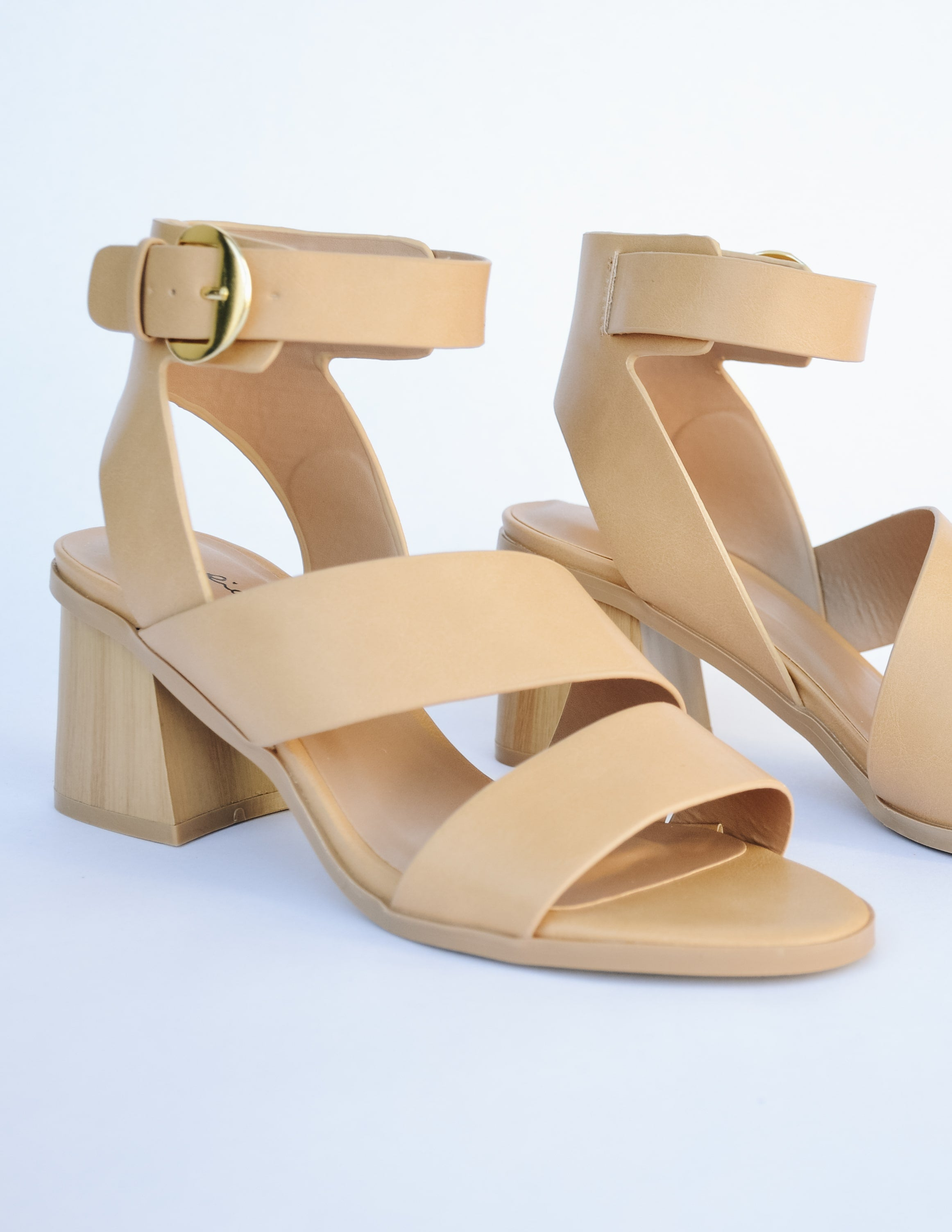Side view of the heel showing light tan strap details and open toe