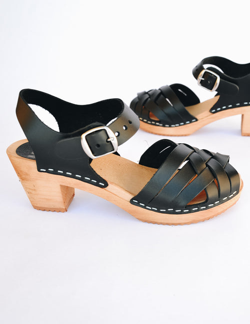 Black mia bety clog with woven upper and adjustable buckle ankle strap