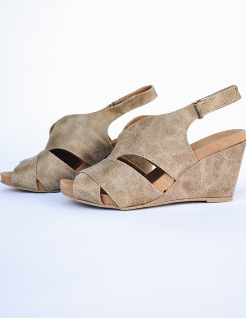 Open toe open slit side upper on the taupe wedge
